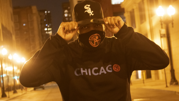 Joseph Hall in a SKUT x The Windy City Chicago Crewneck in Black